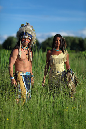 swarty: Indian chief with a young Indian standing in a green meadow Stock Photo