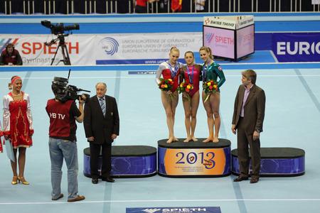 medalist: MOSCOW - APR 20: 2013 European Artistic Gymnastics Championships. Awarding of winners in Vault - Giulia Steingruber (Swiss), Larisa Iordache (Romania) and Noel van Klaveren (Netherlands) in Olympic Stadium on April 20, 2013 in Moscow, Russia