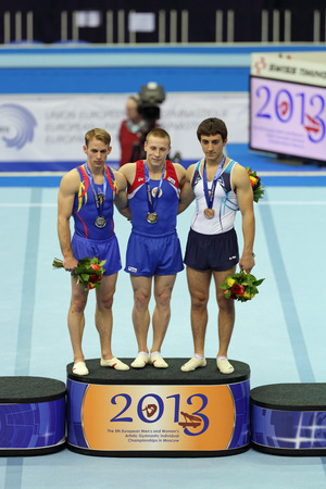 rou: MOSCOW - APR 21: 2013 European Artistic Gymnastics Championships. Awarding of winners in Vault - Denis Ablyazin (RUS), Flavius Koczi (ROU) and Artur Davtyan (ARM) in Olympic Stadium on April 21, 2013 in Moscow, Russia Editorial