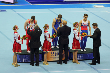 MOSCOW - APR 21: 2013 European Artistic Gymnastics Championships. Awarding of winners in Parallel Bars - Oleg Stepko (UKR), Lucas Fischer (SUI) and David Belyavskiy (RUS) in Olympic Stadium on April 21, 2013 in Moscow, Russia Editorial