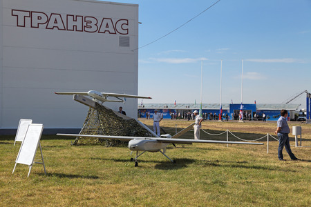 distantly: ZHUKOVSKY, RUSSIA — AUG 11: The Unmanned aerial vehicles (UAV) the production of Transas on celebrating of the 100 anniversary of Russian air force on August, 11, 2012 at Zhukovsky, Russia.  Editorial