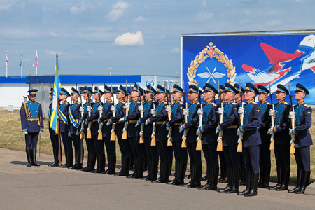ZHUKOVSKY, RUSSIA — AUG 11: The celebrating of the 100 anniversary of Russian air force. August, 11, 2012 at Zhukovsky, Russia. A battalion of the guard of honour of the commandant of the regiment of the air force of Russia meets with the President of R