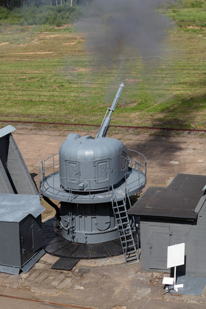 The firing of the ship cannon at the landfill, testing of marine guns Stock Photo