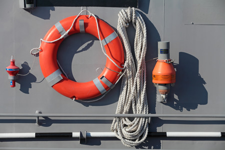 buoys: ST.-PETERSBURG - JUL 03: Lifesaving equipment on Board the ship - lifeline and signal buoys on International maritime defence show (IMDS-2013) on Jul 03, 2013 at Lenexpo exhibition complex in St.-Petersburg, Russia Editorial
