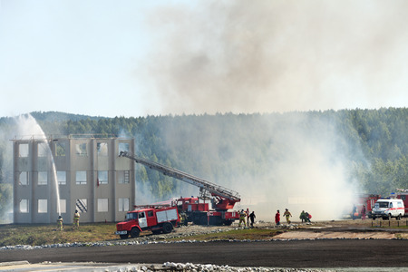 industrially: NIZHNY TAGIL, RUSSIA- AUG 22: Demonstration of work of firemens at the exhibition RUSSIAN DEFENCE EXPO 2012 on August, 22, 2012 in Nizhny Tagil, Russia