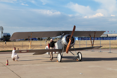 ZHUKOVSKY, RUSSIA — AUG 11: The opening ceremony of celebrating of the 100 anniversary of Russian air force. August, 11, 2012 at Zhukovsky, Russia. Retro aviation, French fighter during the First World war Nieuport-17 Editorial