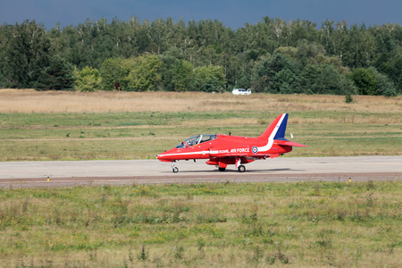 royal air force: ZHUKOVSKY, RUSSIA - AUG 11: The celebrating of the 100 anniversary of Russian air force. August, 11, 2012 at Zhukovsky, Russia. Aerobatic team Red Arrows Royal Air Force of United Kingdom. Landing of the aircraft at the airfield Ramenskoe Editorial