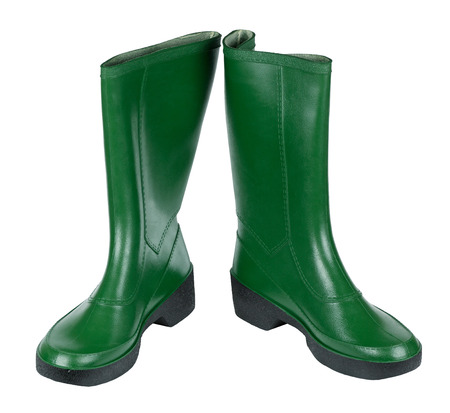 A pair of green rubber boots, isolated on white background
