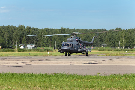 The military helicopter at the airfield preparing for take-off Editorial