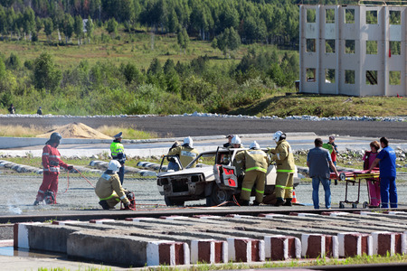 industrially: NIZHNY TAGIL, RUSSIA- AUG 22: The demonstration of the work of the rescuers - the salvation of people from the emergency vehicle at the exhibition RUSSIAN DEFENCE EXPO 2012 on August, 22, 2012 in Nizhny Tagil, Russia Editorial