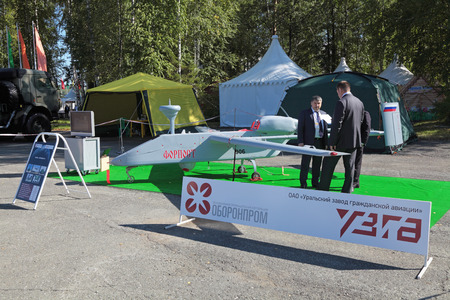 distantly: NIZHNY TAGIL, RUSSIA- AUG 22: Israeli UAV Outpost, the production Ural Works of Civil Aviation at the exhibition RUSSIAN DEFENCE EXPO 2012 on August, 22, 2012 on Nizhny Tagil, Russia