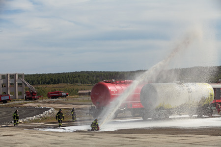 showpiece: NIZHNY TAGIL, RUSSIA- AUG 23: Demonstration of work of firemen, the fire was extinguished by the railway at the exhibition RUSSIAN DEFENCE EXPO 2012 on August, 23, 2012 at Nizhny Tagil, Russia Editorial