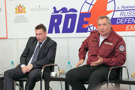 the statesman: NIZHNY TAGIL, RUSSIA - AUG 24: Igor Kholmanskikh - Presidential Plenipotentiary Envoy to the Urals Federal District and Dmitry Rogozin - Ambassador Extraordinary and Plenipotentiary of Russia at RUSSIAN DEFENCE EXPO 2012 on August, 24, 2012 at Nizhny Tagi