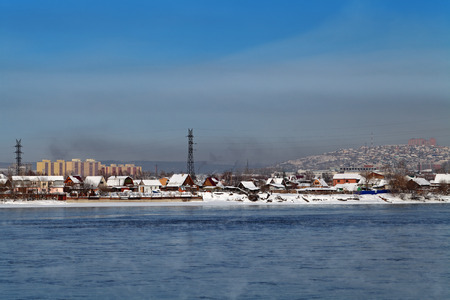 lowrise: Siberia, Russia, winter Irkutsk. Low-rise houses on the Bank of the river Angara
