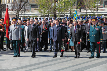 duma: MOSCOW — MAY 8: Measures of Moscow Sergey Sobyanin and deputy Chairman of the Moscow city Duma Andrey Metelsky lays flowers to the monument Tomb of the Unknown Soldier in Alexander Garden. Festive events dedicated to the 67th Anniversary of Victory Day