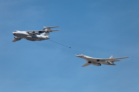 MOSCOW - MAY 09: Celebration of the 68th anniversary of the Victory Day (WWII). Flight of aircraft over the city, the aerial refueling tanker Ilyushin Il-78 and supersonic heavy strategic bomber Tupolev Tu-160 on May 9, 2013 in Moscow, Russia