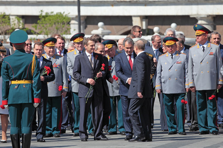 tomb of the unknown soldier: MOSCOW - MAY 8: Vladimir Putin arrived at the ceremony of laying flowers to the Tomb of the Unknown Soldier and welcomes the present politicians. Festive events dedicated to the 67th Anniversary of Victory Day (WWII) on MAY 8, 2013 in Moscow, Russia