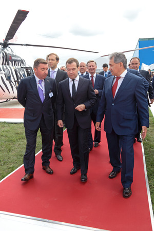 Delegation: ZHUKOVSKY, RUSSIA - AUG 27: Government delegation headed by Dmitry Medvedev at the International Aviation and Space salon MAKS. Aug, 27, 2013 at Zhukovsky, Russia Editorial