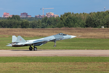 frontline: ZHUKOVSKY, RUSSIA - AUG 28: Landing Sukhoi PAK FA T-50 (Prospective Airborne Complex of Frontline Aviation) fifth-generation jet fighter at the International Aviation and Space salon (MAKS) on August 28, 2013 in Zhukovsky, Russia