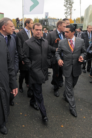 the statesman: NIZHNY TAGIL, RUSSIA - SEP 26: Prime Minister Dmitry Medvedev and General Director Uralvagonzavod Oleg Sienko at the exhibition RUSSIA ARMS EXPO (RAE-2013) on September, 26, 2013 at Nizhny Tagil, Russia