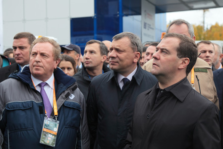 NIZHNY TAGIL, RUSSIA - SEP 26: General Director Automobile plant URAL Victor Korman, Deputy Minister of defense Yuri Borisov and Prime Minister Dmitry Medvedev at the exhibition RUSSIA ARMS EXPO (RAE-2013) on September, 26, 2013 at Nizhny Tagil, Russia