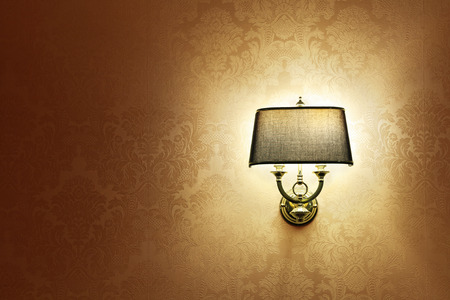 lamp shade: Wall lamp with a shade on the background of brown Wallpaper Stock Photo