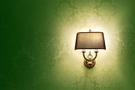 lamp shade: Wall lamp with a shade on the background of green Wallpaper Stock Photo