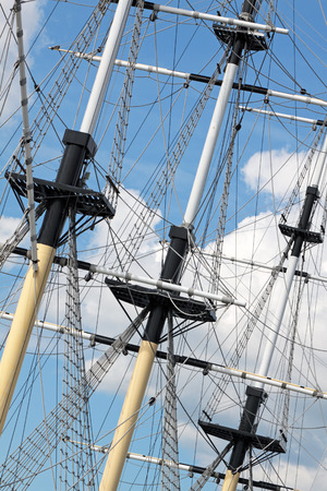 masts: Masts of the sailing ship against the cloudy blue sky Stock Photo