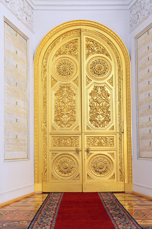 Russia, Moscow, Grand Kremlin Palace - historical old building built from 1837 to 1849, at the present time the ceremonial residence of the President of Russia. Doors in Georgievsky hall