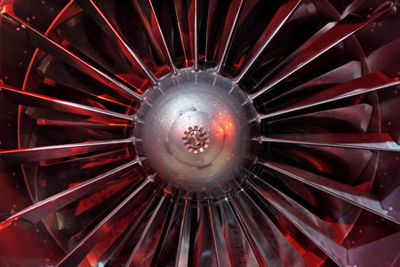 aeroengine: Turbo-jet engine of the plane, close up in the red light