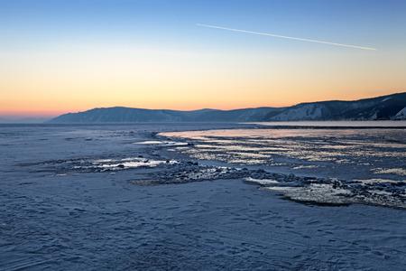 Sunset on lake Baikal in winter, Siberia, Russia photo