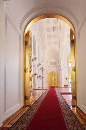 Russia, Moscow, Grand Kremlin Palace - historical old building built from 1837 to 1849, at the present time the ceremonial residence of the President of Russia. Entrance doors in Georgievsky hall