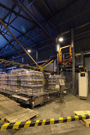 storeroom: MOSCOW, RUSSIA, OCHAKOVO BREWERY - JUN 13, 2013: The biggest Russian company beer and beverage industry. Warehouse of finished products company Editorial