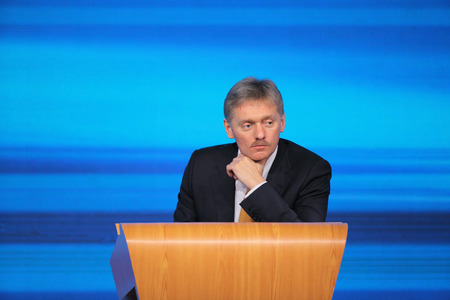 attache: MOSCOW, RUSSIA - DEC 19: The Dmitry Sergeyevich Peskov - Press Attache for the President of Russian Federation Vladimir Putin, Deputy head of the Presidential at annual press conference in Center of international trade