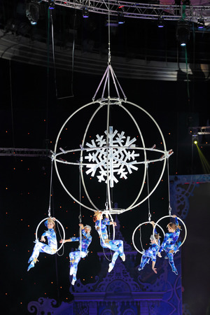 trapeze: MOSCOW, RUSSIA - JAN 06, 2013: Childrens new year performance Circus Santa Claus II - Olympic New Year in Olympic Stadium (sport complex). The performance of the trapeze artists