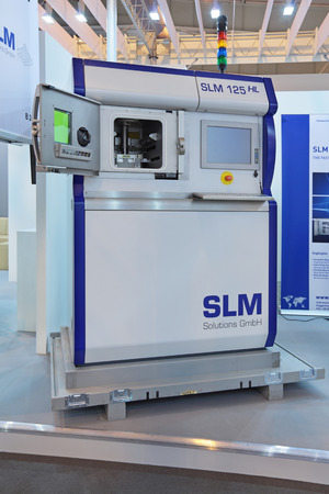 complex system: ZHUKOVSKY, RUSSIA - AUG 31, 2013: The new compact Selective Laser Melting System 125 HL produces highly complex metal components using fine metal powders from 3D CAD data files SLM Solutions GmbH company at the International Aviation and Space salon MAKS-