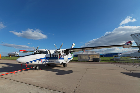 twin engine: ZHUKOVSKY, RUSSIA - AUG 27, 2013: Let L-410 UVP-E20 - Czech universal twin-engine aircraft for local airlines at the International Aviation and Space salon MAKS-2013 Editorial