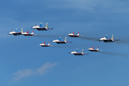 mig: ZHUKOVSKY, RUSSIA - AUG 28, 2013: Аerobatic teams Swifts (Strizhi) on planes MiG-29 and Russian Knights on planes Su-27 at the International Aviation and Space salon MAKS-2013