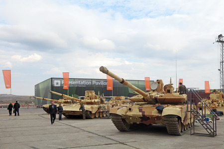 industrially: NIZHNY TAGIL, RUSSIA - SEP 26, 2013: The international exhibition of armament, military equipment and ammunition RUSSIA ARMS EXPO (RAE-2013). The T-90 Russian third-generation main battle tank Editorial
