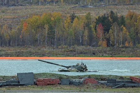 self testing: NIZHNY TAGIL, RUSSIA - SEP 25, 2013: The international exhibition of armament, military equipment and ammunition RUSSIA ARMS EXPO (RAE-2013). The 2S25 Sprut-SD is a self-propelled tank destroyer or light tank