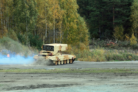 industrially: NIZHNY TAGIL, RUSSIA - SEP 25, 2013: The international exhibition of armament, military equipment and ammunition RUSSIA ARMS EXPO (RAE-2013). Russian Heavy Flame Thrower System, multiple rocket launcher TOS-1