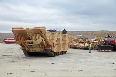 industrially: NIZHNY TAGIL, RUSSIA - SEP 25, 2013: The international exhibition of armament, military equipment and ammunition RUSSIA ARMS EXPO (RAE-2013). Amphibious Carrier production Uralvagonzavod (UVZ)