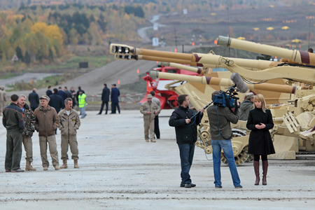 industrially: NIZHNY TAGIL, RUSSIA - SEP 25, 2013: Journalists at the international exhibition of armament, military equipment and ammunition RUSSIA ARMS EXPO (RAE-2013)