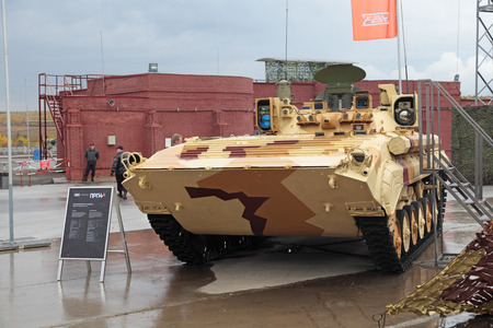 armament: NIZHNY TAGIL, RUSSIA - SEP 26, 2013: The international exhibition of armament, military equipment and ammunition RUSSIA ARMS EXPO (RAE-2013). Military armoured vehicle - mobile reconnaissance post PRP4A