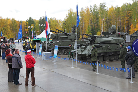 NIZHNY TAGIL, RUSSIA - SEP 24, 2013: The international exhibition of armament, military equipment and ammunition RUSSIA ARMS EXPO (RAE-2013). Air defense cannon-missile complex 9K22 Tunguska and antiaircraft self-propelled installation ZSU-23-4 Shilka
