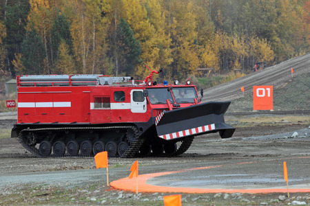 showpiece: NIZHNY TAGIL, RUSSIA - SEP 26, 2013: The international exhibition of armament, military equipment and ammunition RUSSIA ARMS EXPO (RAE-2013). Caterpillar fire truck to extinguish forest fires Editorial