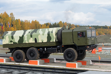 NIZHNY TAGIL, RUSSIA - SEP 26, 2013: The international exhibition of armament, military equipment and ammunition RUSSIA ARMS EXPO (RAE-2013). Freight military vehicle VOLAT production MZKT - Minsk Wheel Tractor Plant