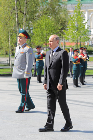 tomb of the unknown soldier: MOSCOW, RUSSIA - MAY 8, 2014: Vladimir Putin at the ceremony of laying flowers to the Tomb of the Unknown Soldier. Festive events dedicated to the 69th Anniversary of Victory Day (WWII)