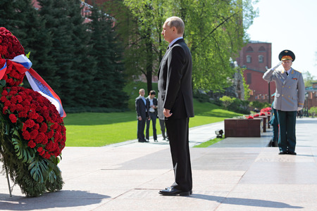 triumphant: MOSCOW, RUSSIA - MAY 8, 2014: Vladimir Putin at the ceremony of laying flowers to the Tomb of the Unknown Soldier. Festive events dedicated to the 69th Anniversary of Victory Day (WWII)