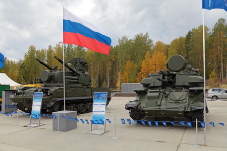 armament: NIZHNY TAGIL, RUSSIA - SEP 24, 2013: The international exhibition of armament, military equipment and ammunition RUSSIA ARMS EXPO (RAE-2013).  Air defense cannon-missile complex 9K22 Tunguska and antiaircraft self-propelled installation ZSU-23-4 Shilka